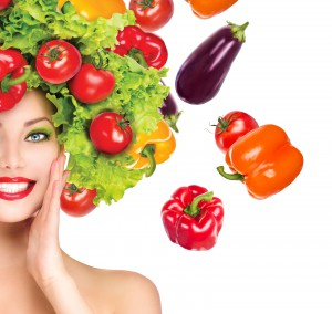 Beauty girl with Vegetables hair style. Beautiful happy young wo